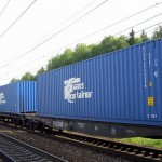 Transportation of containers by railway transport